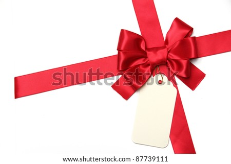 Red ribbon bow with blank gift tag.Isolated on white. - stock photo