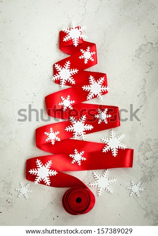Red Ribbon Christmas Tree with decor on the cracked vintage background