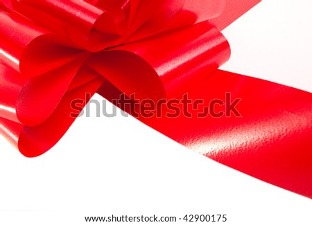 Red ribbon closeup isolated on white