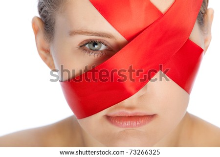 red ribbon covers face of a young woman