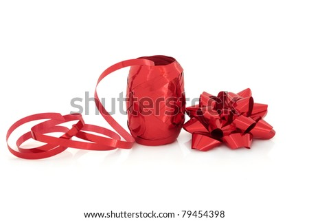Red ribbon gift and bow decoration, isolated over white background.