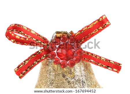 Red ribbon on Christmas kingle bell. Isolated on a white background.