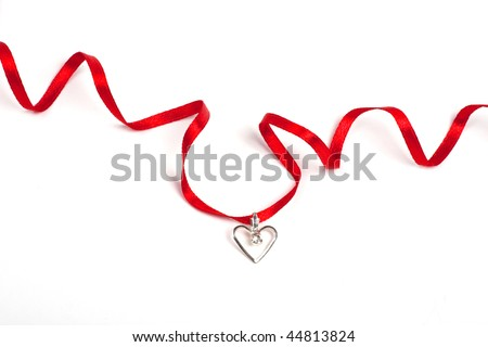 Red ribbon with heart, Isolated over white