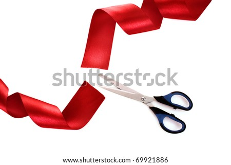 Red ribbon with scissors isolated on white