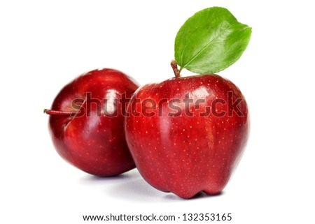 Red ripe apples on white