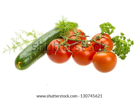 Red ripe tomatoes on the branch with parsley, dill, cucumber #130745621