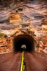 Red Road Leads into Tunnel Through Rock in Zion National Park