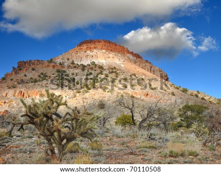 Red rock capped mesa in the Mojave National Preservation, California.