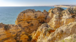 red rock cliffs from Lagos in Portugal. rocky bright sandstones near the Lagos in Portugal