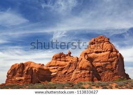 Red Rock Formations in Arches National Park with dramatic Blue Sky