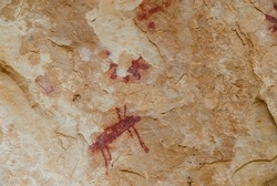 Red rock paintings in the lapel of the eagle on limestone rock in the gorges of the duraton dated to the bronze age