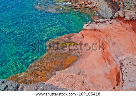 Red rocks by the ocean, viewed from above