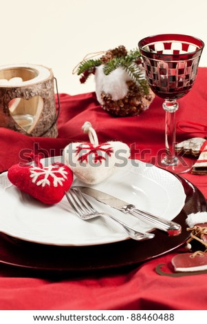 Red, romantic place setting for christmas or celebration wit white and red heart