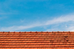 Red roof and blue sky background