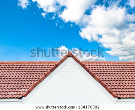 red rooftop against blue sky