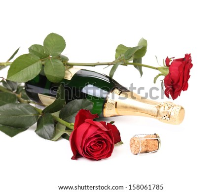Red rose and a bottle of champagne. Isolated on a white background