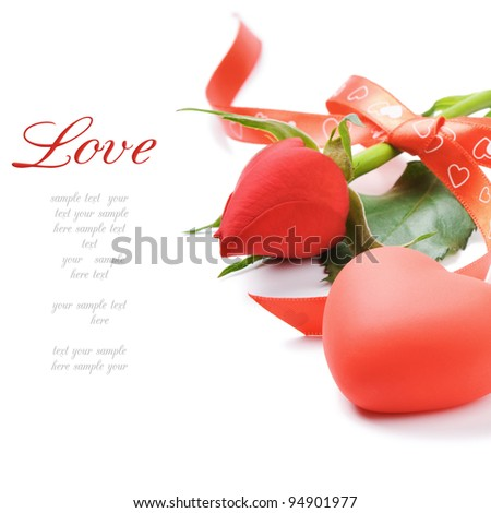 Red rose and heart-shaped decoration over white