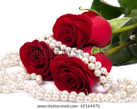 Red rose and pearls on white background - stock photo
