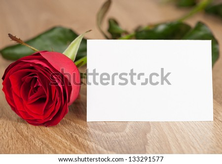 red rose and white sheet on wood