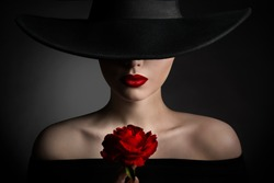 Red Rose Flower Woman Lips and Black Hat, Elegant Fashion Model Beauty Portrait, Lady in Wide Broad Brim Hat on Dark Background