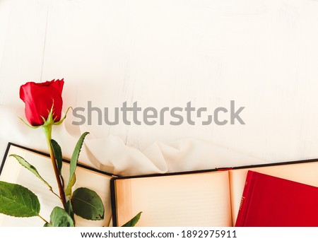 Red rose next to open books and closed books on white background. Perfect for Sant Jordi or for Valentine's Day. Photo stock ©