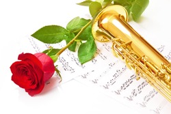Red rose, saxophone and notes on a white background