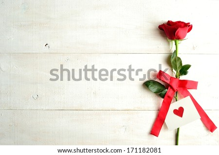 Red rose with message card.Image of Valentines day.