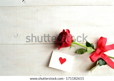 Red rose with message card.Image of Valentines day