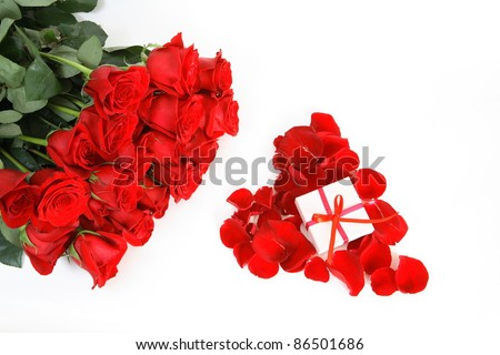 red roses and a box on a white background