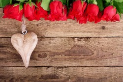 red roses and a heart on wooden board, Valentines Day background,  wedding day