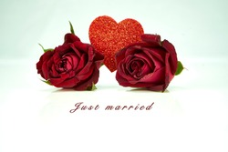 Red roses and heart on white background with Words Just married