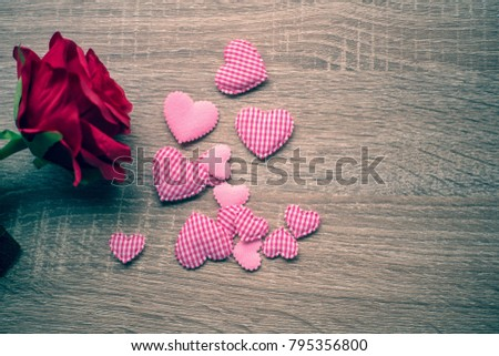Red roses and heart on wooden table background for Valentines day background #795356800