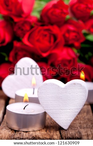 red roses and white hearts with candles on wooden board, Valentines Day background,  wedding day