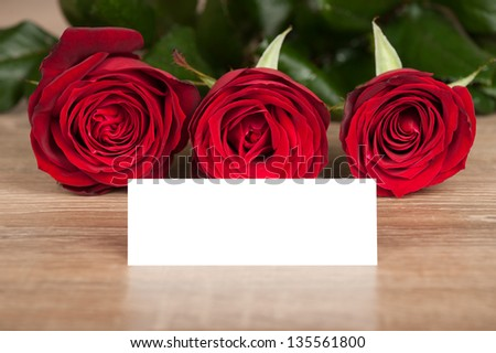 red roses and white sheet on wood