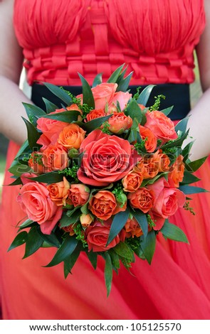 red roses  flowers bride bouquet with unconventional red dressed bride