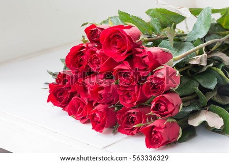 Red roses on white table for valentine's day #563336329