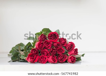 Red roses on white table for valentine's day #567741982