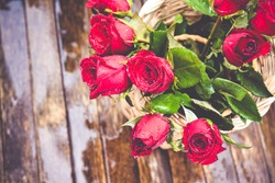 Red roses on wood background, Valentines Day background, wedding day