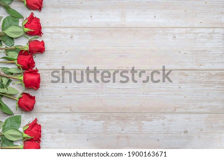 Red roses, wooden surface. Layout for postcards, invitations for Valentine's Day 14 february, Engagement, wedding anniversary, romantic evening  preparation. Stockfoto ©