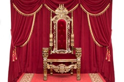 Red royal chair on a background of red curtains. Place for the king. Throne
