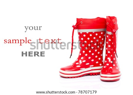 Red rubber boots for kids isolated on white background (with space for text)