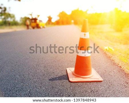 Red rubber cone placed on the road to ensure safety #1397848943