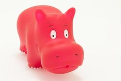 red rubber hippopotamus toy on white background