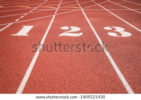 Red running track or athlete track with lane numbers
