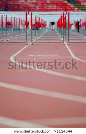 red running tracks with hurdles set up for training