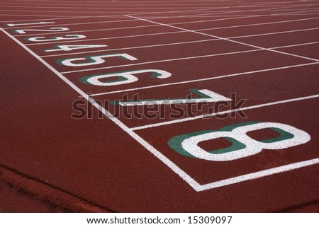 red running tracks with starting numbers from one to eight