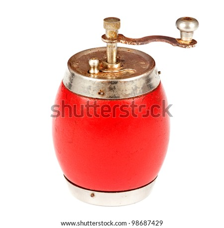 Red,russian antique,old and rusty pepper mill or grinder isolated on white background