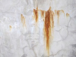 red rust leaks on concrete wall texture.