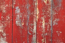 Red rustic reclaimed wooden wall background.