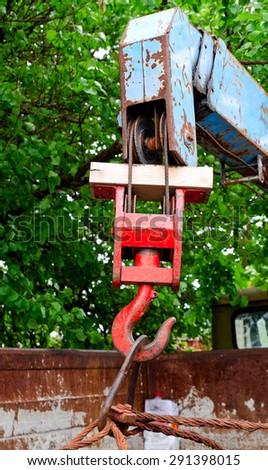 red rusty old metal hook the manipulator